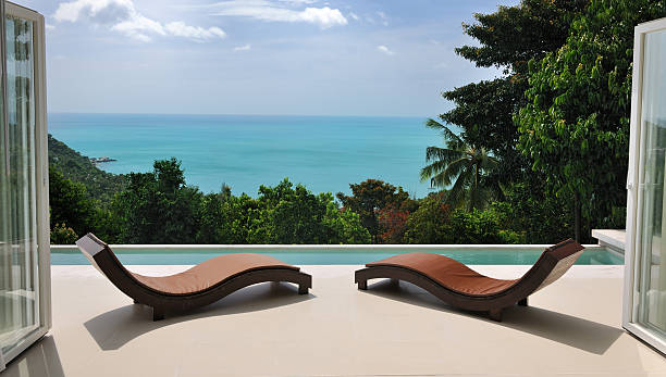 Brown chaise lounges at private pool villa:スマホ壁紙(壁紙.com)