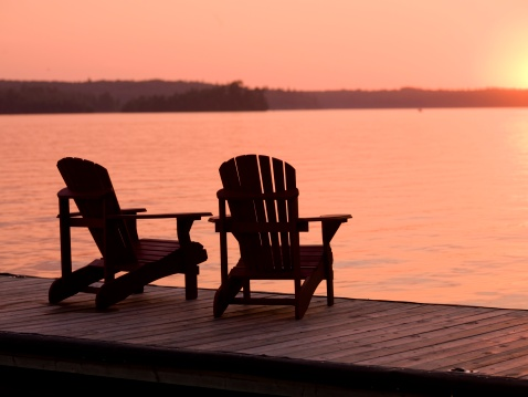 Outdoor Chair「Lake of the Woods, Ontario, Canada, Adirondack chairs on a dock facing the sunset」:スマホ壁紙(13)