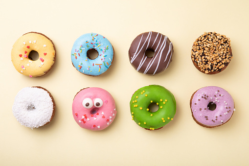 Icing「Top view of set of donuts on yellow background. Flat lay, copy space.」:スマホ壁紙(11)