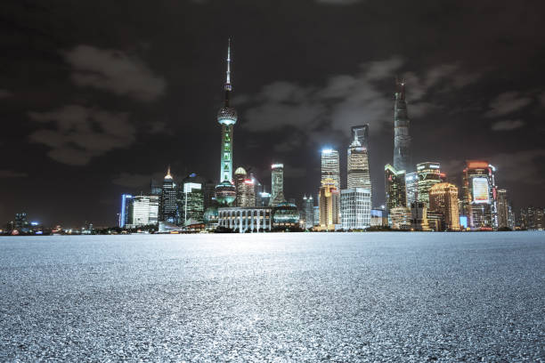 Empty asphalt road with Shanghai Pudong in the background at night:スマホ壁紙(壁紙.com)