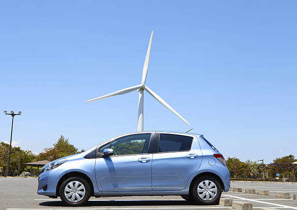 Wind turbine and a car:スマホ壁紙(壁紙.com)