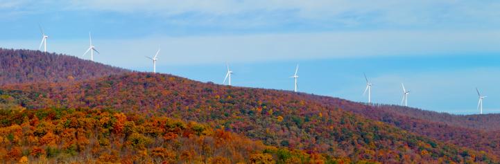 Generator「Wind turbines along a mountain ridge in autumn」:スマホ壁紙(1)