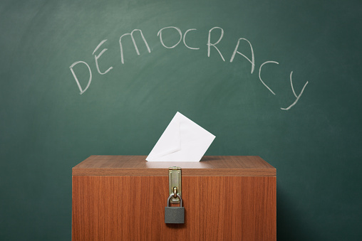 Voting Booth「Ballot Box Before Green Blackboard With Word Democracy Written On」:スマホ壁紙(2)