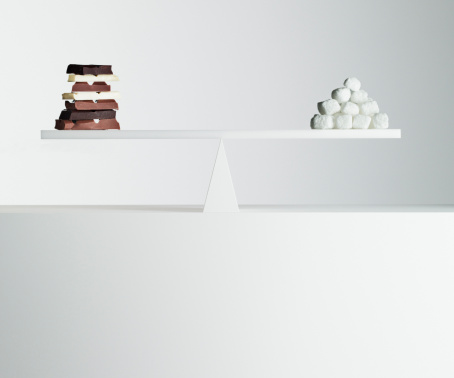Milk Chocolate「Chocolate bars and stack of sugar cubes balanced on seesaw」:スマホ壁紙(17)