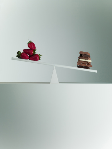 Milk Chocolate「Chocolate bars tipping seesaw with strawberries on opposite end」:スマホ壁紙(4)