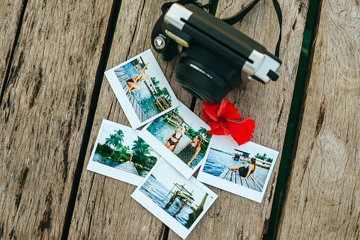 Central America「Panama, Bocas del Toro, Instant photographs and camera on wooden jetty」:スマホ壁紙(0)