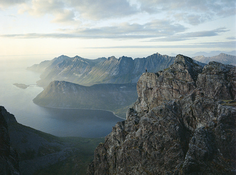 Caucasian Ethnicity「Tiny figure of person looking at splendid view from mountains on Senja Island」:スマホ壁紙(1)