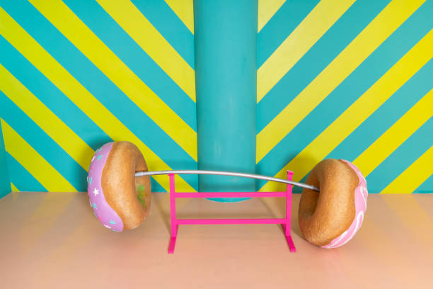 Oversized donuts as barbell at an indoor theme park:スマホ壁紙(壁紙.com)