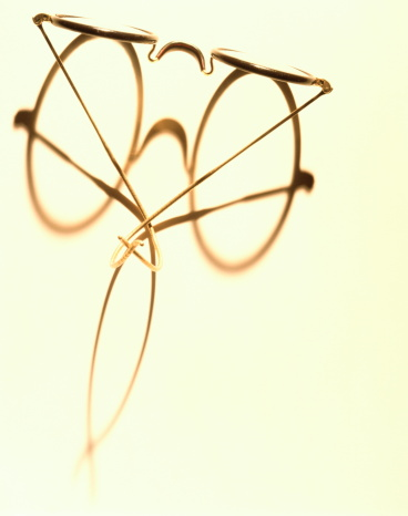 Eyeglasses「Wire framed glasses casting shadow, overhead view (toned B&W)」:スマホ壁紙(9)
