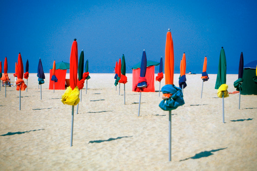 France「Closed umbrellas on Normandy Beach in North Deauville, France, Europe」:スマホ壁紙(7)