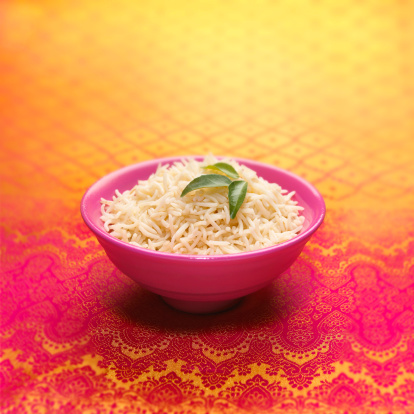 Basmati Rice「Bowl of basmati rice decorated with curry leaves」:スマホ壁紙(6)