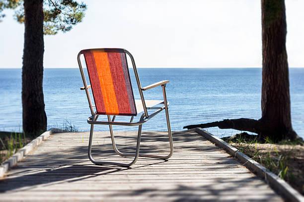 Estonia, Kauksi, beach chair on wooden boardwalk at lake Peipsi:スマホ壁紙(壁紙.com)