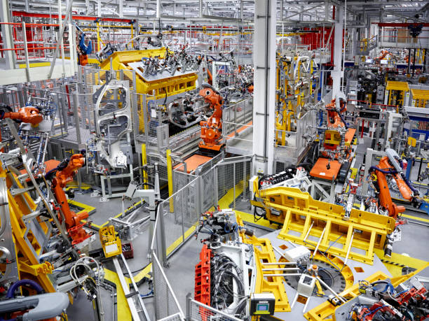 Robot arms in a car manufacturing factory:スマホ壁紙(壁紙.com)