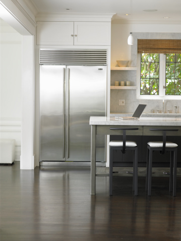 Kitchen Counter「Laptop on counter in domestic kitchen」:スマホ壁紙(14)