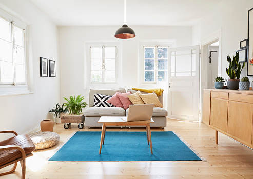 Home Ownership「Laptop on coffee table in a modern living room of an old country house」:スマホ壁紙(5)