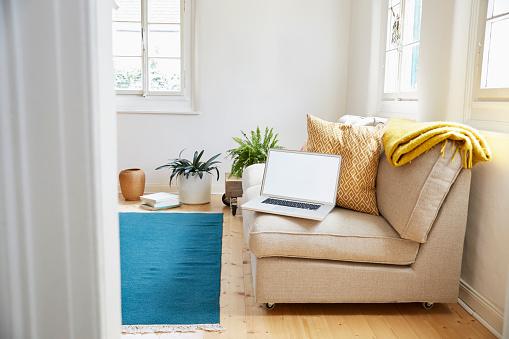 毛布「Laptop on couch in a modern living room of an old country house」:スマホ壁紙(17)