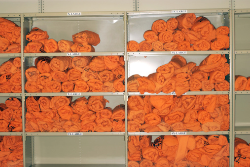 Prisoner「A shelf containing orange clothing to be issued to prisoners.」:スマホ壁紙(14)