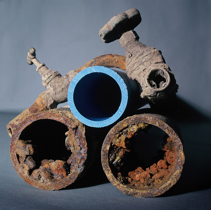 Isle of Man「Old corroded rusty metal domestic water pipes alongside a new plastic pipe」:スマホ壁紙(4)
