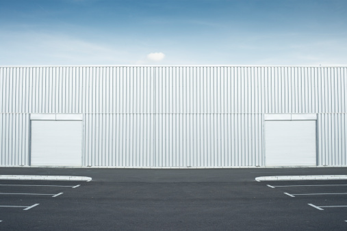 Parking Lot「An empty car parking lot behind a warehouse」:スマホ壁紙(3)