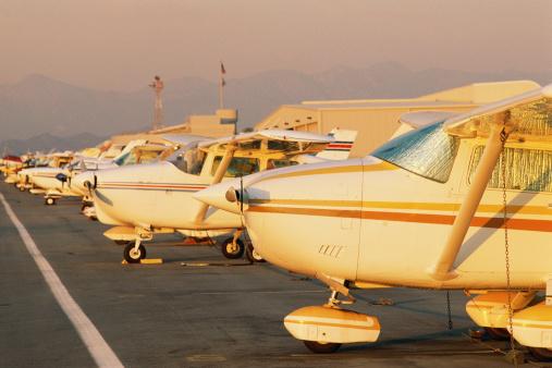 Passenger「Small passenger aircraft parked at airport」:スマホ壁紙(14)