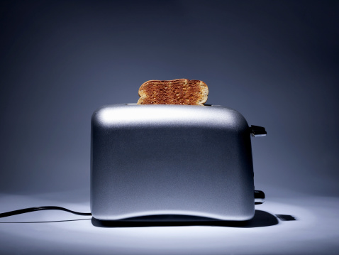 Gray Background「Silver colored toaster with single slice of toast.」:スマホ壁紙(3)