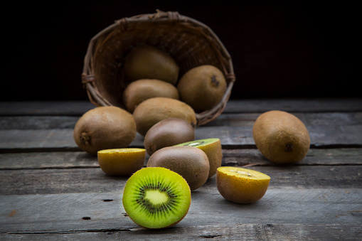 Kiwi「Green and golden kiwis, basket on wood」:スマホ壁紙(0)