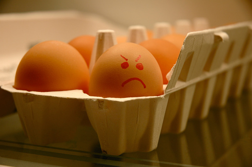 Frowning「Carton of Eggs with one Egg Displaying an Angry Face」:スマホ壁紙(7)