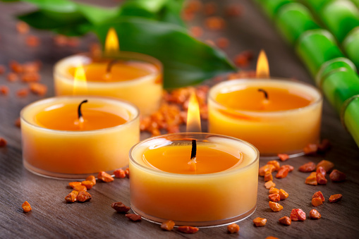 Health Spa「Small orange candles and stones with bamboo decoration」:スマホ壁紙(1)