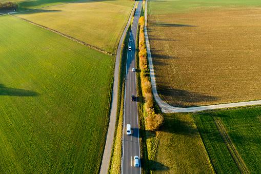 Plowed Field「Cars on Rural Road in Autumn, Aerial View」:スマホ壁紙(15)