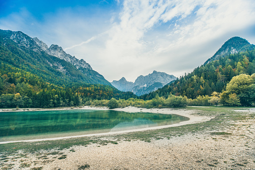 River「Lake Jasna Beach In Slovenian Julian Alps」:スマホ壁紙(1)