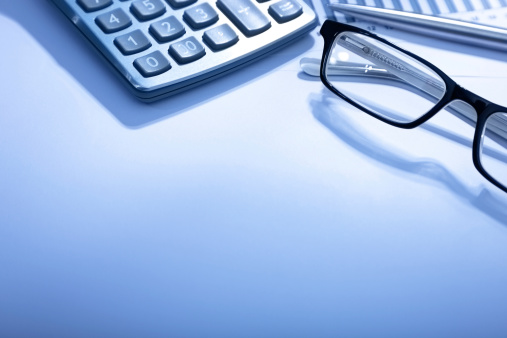 Annual Event「Partial view of a calculator and glasses on a white desk」:スマホ壁紙(15)