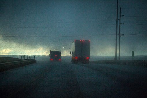 Boise「Trucks driving on stormy rural road」:スマホ壁紙(10)