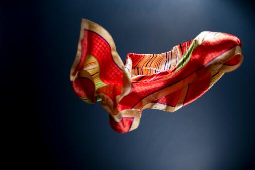スカーフ「Floating multicolored scarf on a blue background」:スマホ壁紙(1)