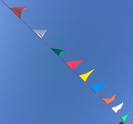 Bunting「Colorful flags fluttering in the wind」:スマホ壁紙(11)