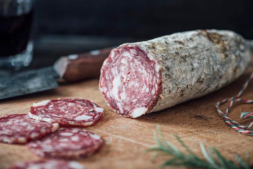 Salami「Sliced salami on cutting board」:スマホ壁紙(8)