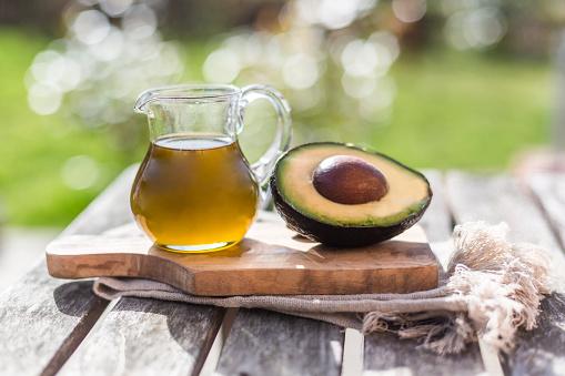 Avocado「Half of avocado and glass jug of avocado oil on wooden board」:スマホ壁紙(13)