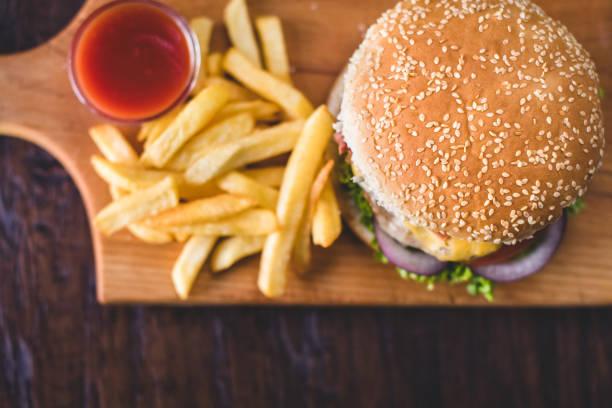 Homemade burgers on rustic wooden background:スマホ壁紙(壁紙.com)