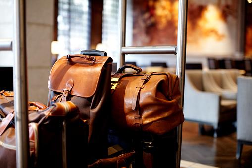 旅行「Luggage on a bell cart in a hotel lobby」:スマホ壁紙(18)