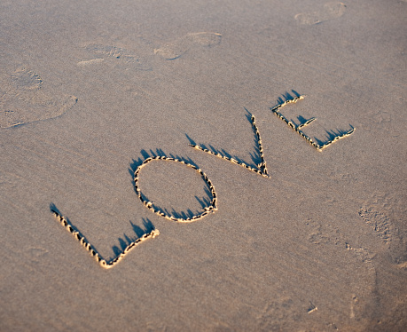 Cannon Beach「The word Love spelled out in the sand.」:スマホ壁紙(12)