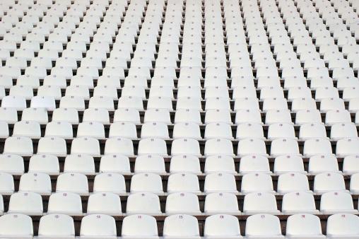 Full「Numerous rows of white stadium seats」:スマホ壁紙(3)