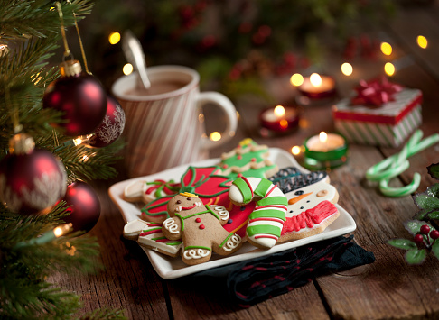 Candy Cane「Christmas gingerbread man and iced cookies on an old wood background」:スマホ壁紙(3)