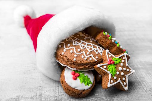 Gingerbread Cookie「Christmas gingerbread in Santa hat on wooden board」:スマホ壁紙(1)