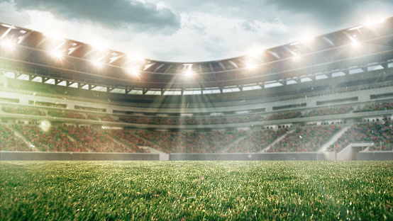 Fashion Model「Soccer field with illumination, green grass and cloudy sky, background for design or advertising」:スマホ壁紙(0)