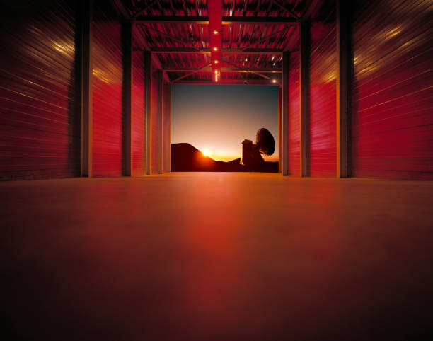 Red lit corridor leading towards landscape with radio telescope at sunset:スマホ壁紙(壁紙.com)