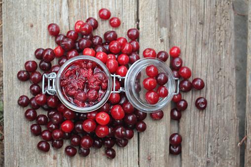 Cherry「Sour cherry chutney in a jar with fresh cherries around.」:スマホ壁紙(8)