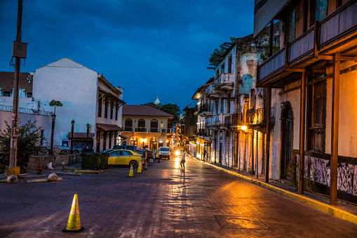 Motorcycle「Night shot of Casco Viejo also called Casco Antiguo, Panama City's Old Quarter established in 1673, with its old buildings and an unrecognizable person in background.」:スマホ壁紙(14)