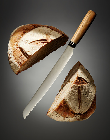 Loaf of Bread「Bread Knife Slicing Through a Loaf」:スマホ壁紙(19)