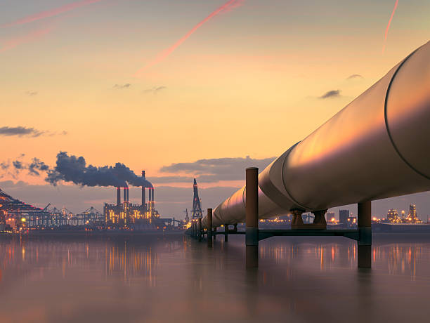 Oil pipeline in industrial district with factories at dusk:スマホ壁紙(壁紙.com)