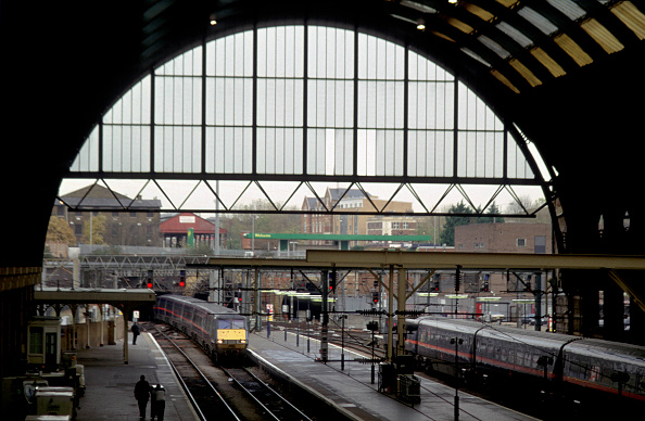 Overcast「Overview of the trainshed at London's Kings Cross station with a train entering at the end of its journey from the north.」:写真・画像(13)[壁紙.com]