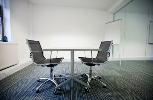 Meeting「Side view of small table and two chairs in office」:スマホ壁紙(14)